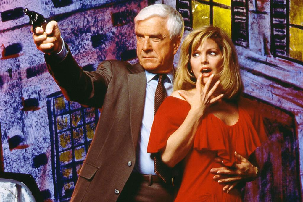 SHIRLEY NOT: Leslie Nielsen poses with Priscilla Presley during a benefit screening of Naked Gun 33 1/3 : The Final Insult.