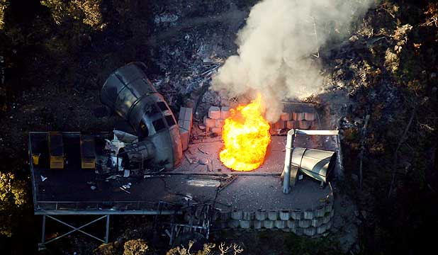 BURNING: Flames coming out of a ventilation shaft at Pike River Mine on Monday.