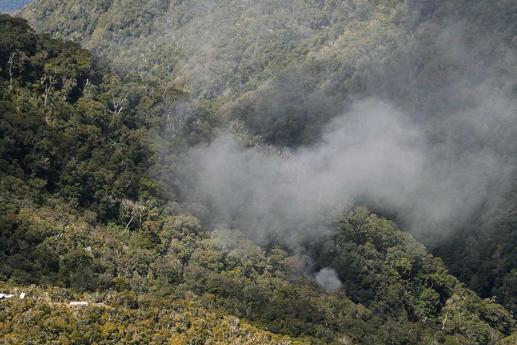 FIRE: Smoke rises from a ventilation shaft at the Pike River mine.