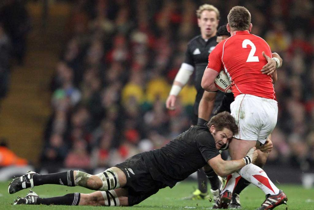CAPTAIN TO CAPTAIN: McCaw puts a tackle on his counterpart, Welsh captain Matthew Rees.