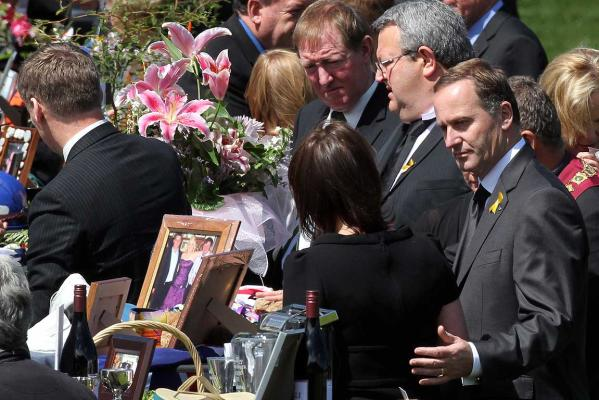 Prime Minister John Key comforts his wife Broghan after paying respects to the 29 tables representing dead miners.