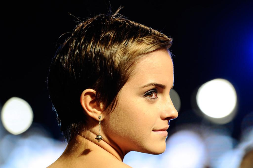 """HOT PROPERTY: Britain's Emma Watson poses as she arrives for the world premiere of """"Harry Potter and the Deathly Hallows: Part 1"""" at Leicester Square in London November 11, 2010."""