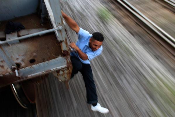 Reuters Images of the Year, photo of Hondurian man crossing US border on train.
