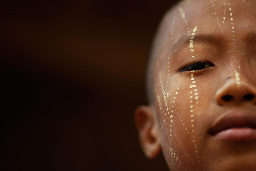 Reuters Images of the Year, photo of boy with his face decorated.