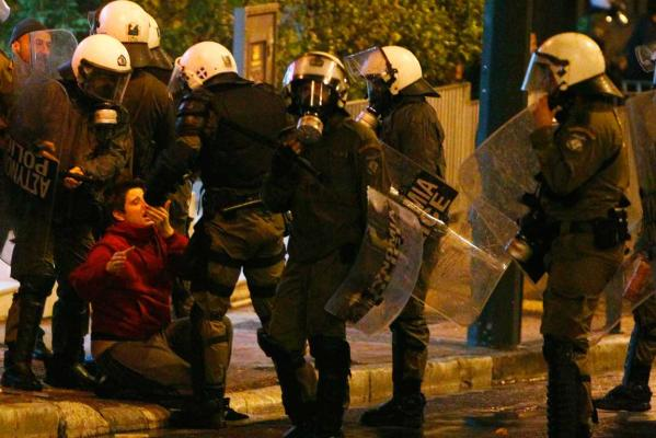 Reuters Images of the Year, photo of protester being slapped in Athens otuside US embassy.