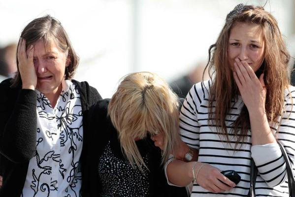 Reuters Images of the Year, photo of mourning relatives of Pike River victims.