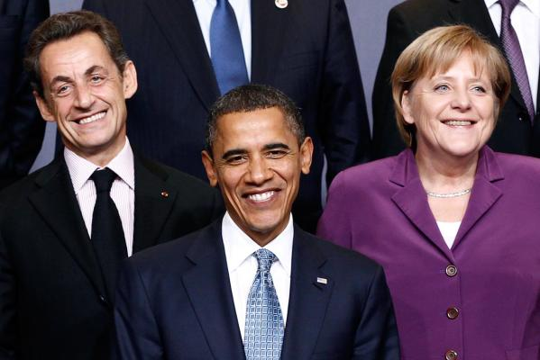 Reuters Images of the Year, photo of Sarkozy, Obama and Merkel at NATO summit.