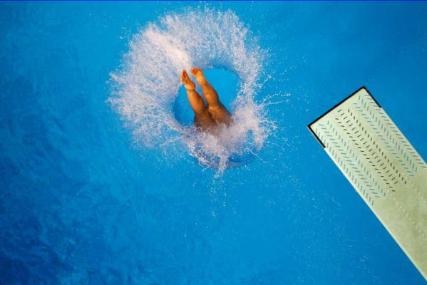 Reuters Images of the Year, photo of competitor diving in 16th Asian Games.