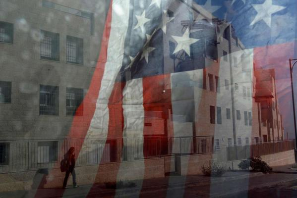 Reuters Images of the Year, photo of Israeli woman reflected in american flags in Giviat Zeev.