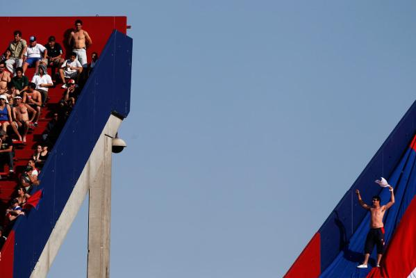 Reuters Images of the Year, photo of San Lorenzo de Almagro gestures at other fans.