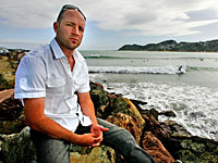 NASTY SURPRISE: James Whitaker is still trying to get rid of the stench of the sewage he came across while surfing in Lyall Bay yesterday.