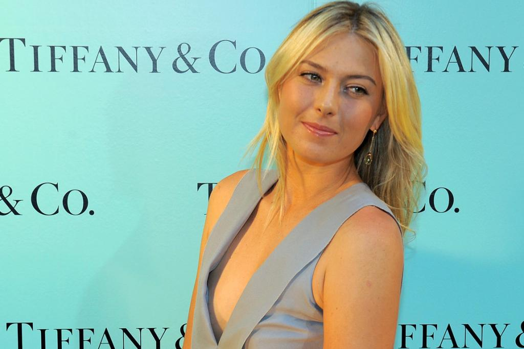 Maria Sharapova models earrings from Tiffanys that she was to wear while playing at the Australian Open in 2010.