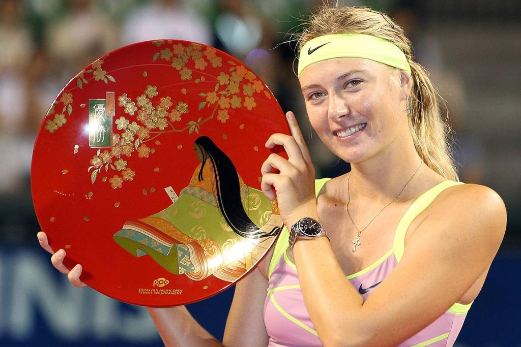 Maria Sharapova poses with the trophy after winning the women's final against Jelena Jankovic at  Toray Pan Pacific Open Tennis tournament in 2009.
