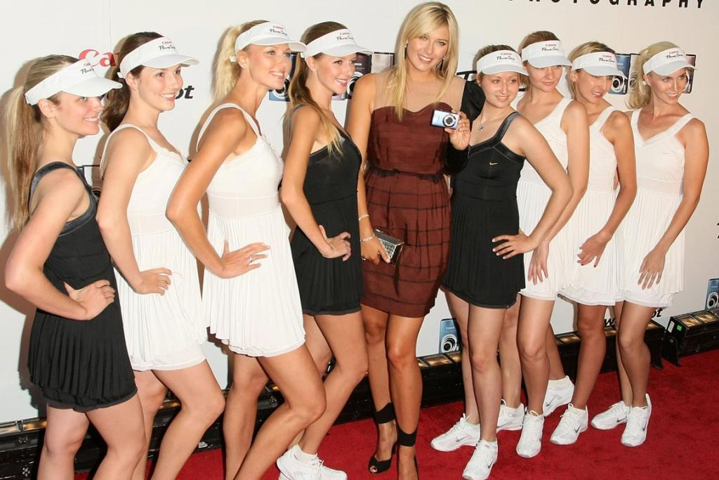 Tennis star Maria Sharapova (centre) poses with Maria Sarapova look-alike models at the unveiling of the new Canon PowerShot Diamond Collection in New York City in 2008.