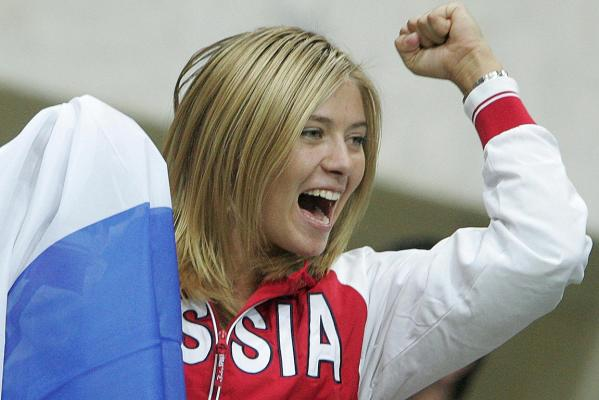 Russian Maria Sharapova reacts after her compatriot Svetlana Kuznetsova won the decisive game of Fed Cup World Group women's tennis final against Italy in 2007.