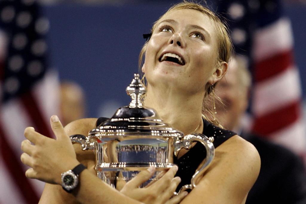 Maria Sharapova holds her trophy as the lid comes off  after winning the woman's singles final at the 2006 US Open in New York.
