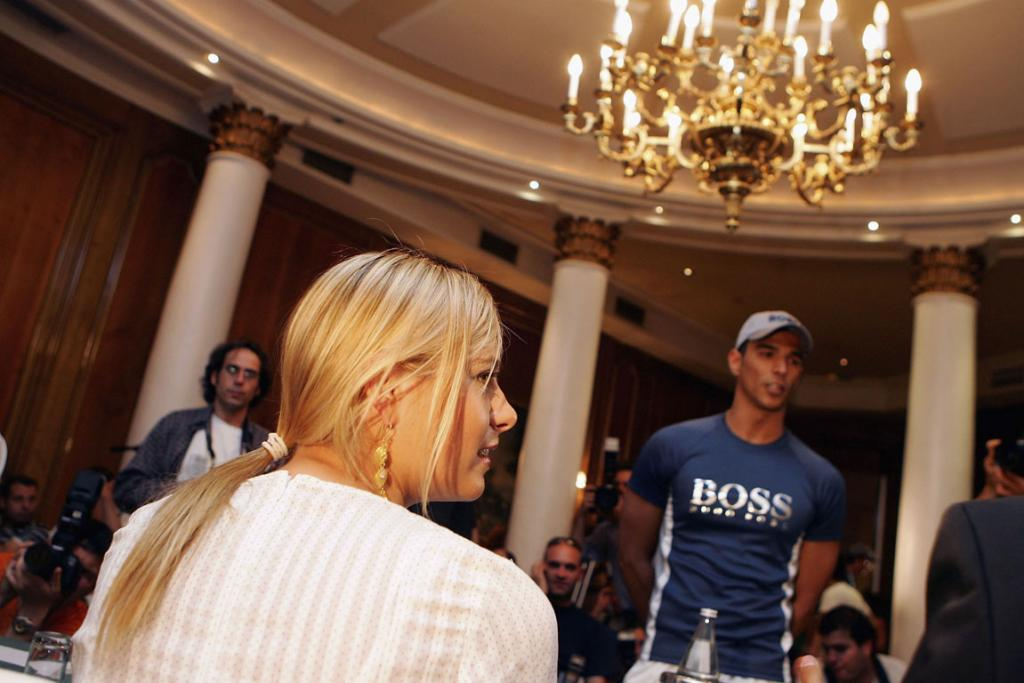Maria Sharapova interviews a model at the Palace hotel in 2006 in Madrid. Models were selected to work as ballboys for the Women's Tennis Championshoips in Madrid that year.