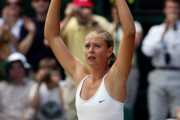Maria Sharapova celebrates winning the women's singles final against Serena Williams at Wimbledon in 2004.