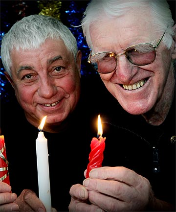 CONCERT CANDLES: Rotary Club of Timaru South members Brian Chandler (left) and Ray Brosnahan prepare for this year's Carols by Candlelight concert.