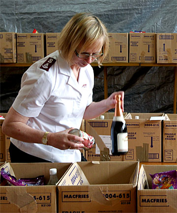 FOOD FOR FAMILIES: Salvation Army's Edwina Herring puts the finishing touches to around 150 boxes for needy families in the Timaru area.