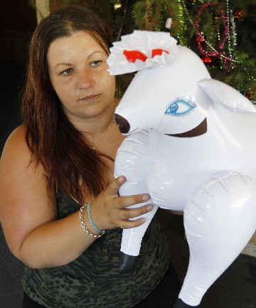 Nicola Quinn with the sex toy her seven-year-old daughter won at the Tahunanui Arts and Crafts Fair.