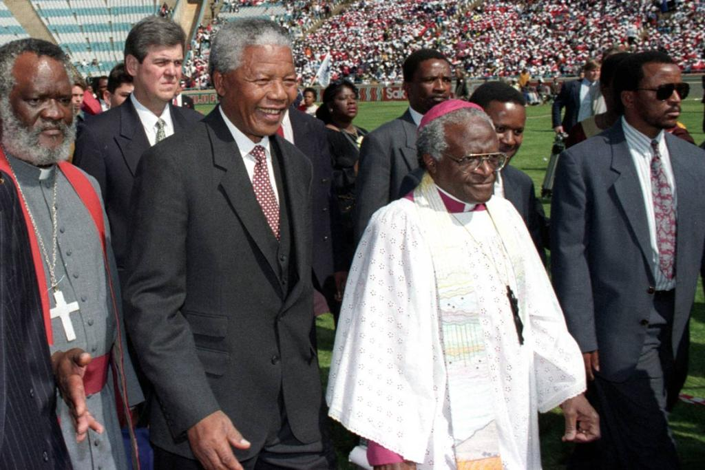 Nelson Mandela, second left, at a open-air service for the country's Christian community at a football stadium in the township of Soweto, in 1994.