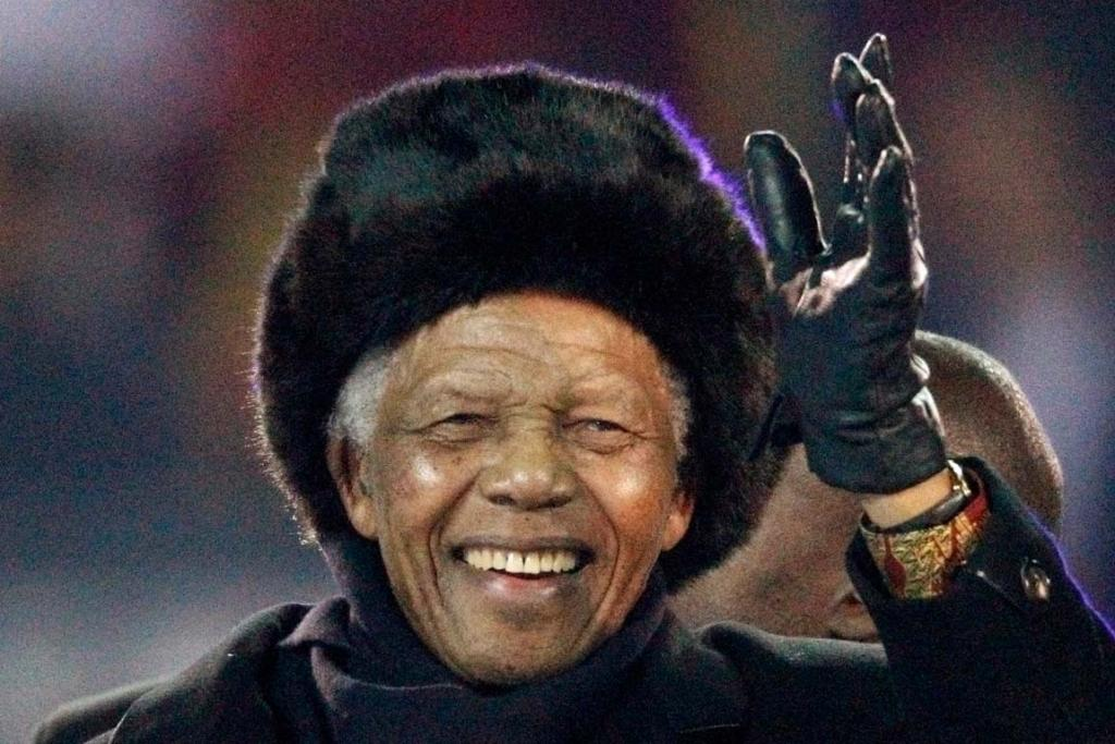 Former South African President Nelson Mandela waves to the crowd at Soccer City stadium during the closing ceremony for the 2010 World Cup in Johannesburg July 11, 2010.