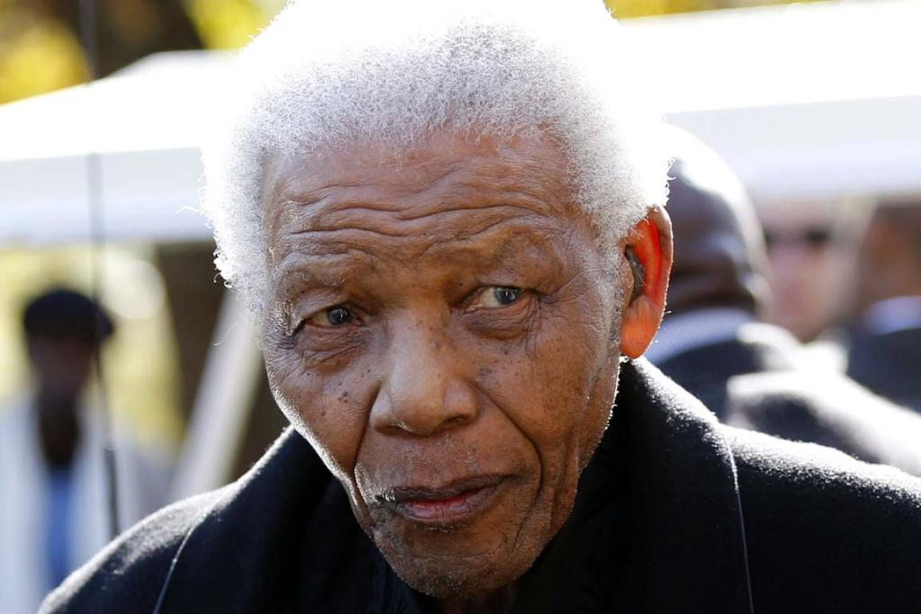 Former South African President Nelson Mandela leaves after attending the memorial service of his great-granddaughter Zenani Mandela, at the St Stithians College Chapel in Sandton, north of Johannesburg June 17, 2010.