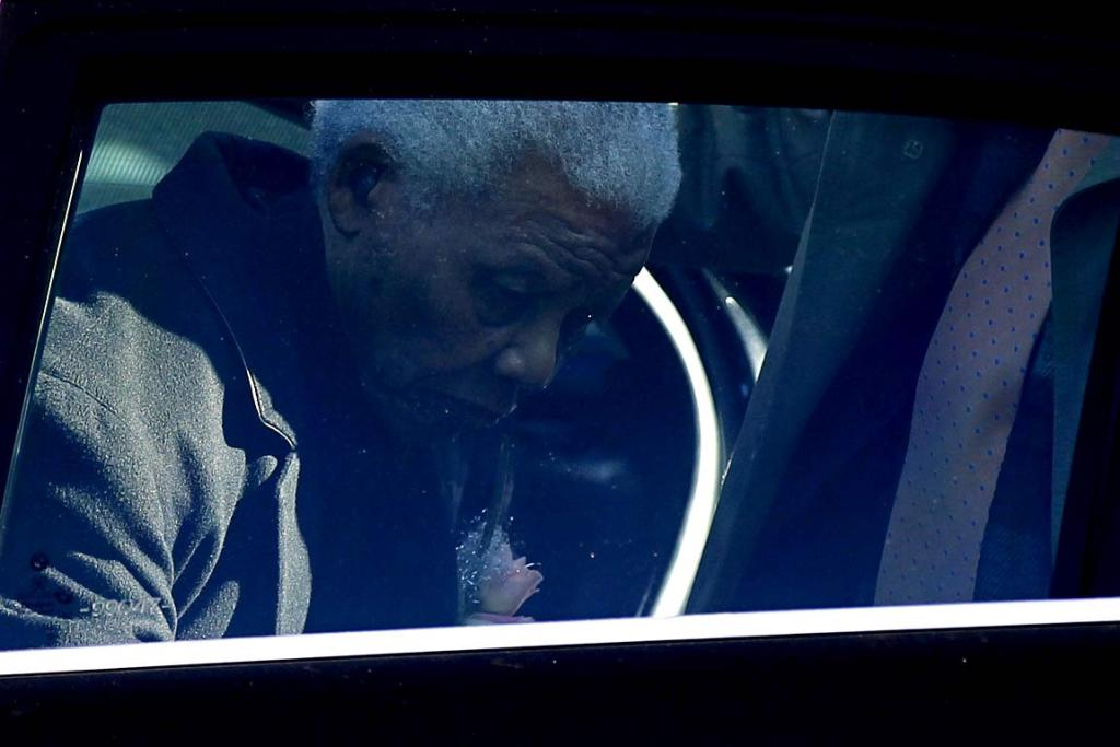 Former South African President Nelson Mandela arrives to attend the memorial service of his great-granddaughter Zenani Mandela at the St Stithians College Chapel in Sandton, north of Johannesburg June 17, 2010.
