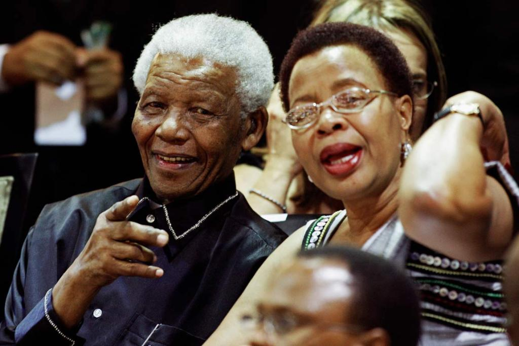 South Africa's former president Nelson Mandela, left, and his wife Graca Machel sit in the gallery at the opening of Parliament in Cape Town February 11, 2010.