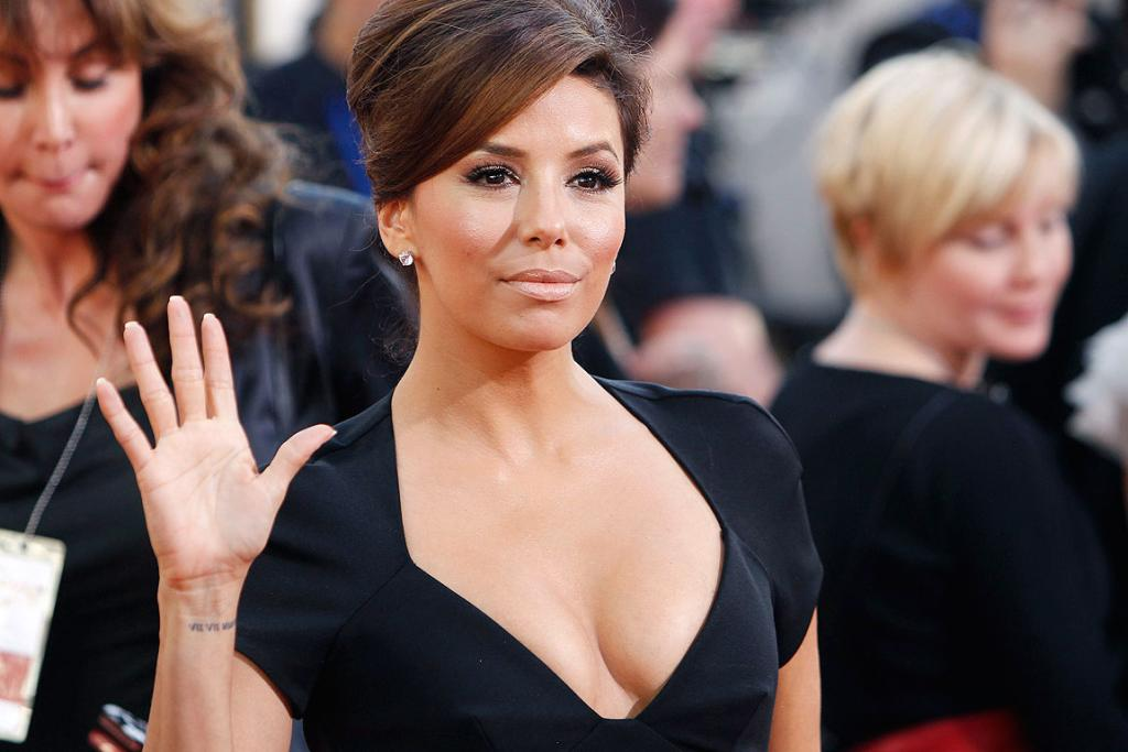 HI EVERYONE: Actress Eva Longoria arrives at the 68th annual Golden Globes Awards in Beverly Hills.