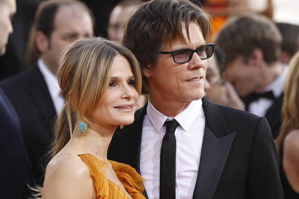 GOLDEN COUPLE: Kevin Bacon and his wife, actress Kyra Sedgwick, arrive at the 68th annual Golden Globe Awards.
