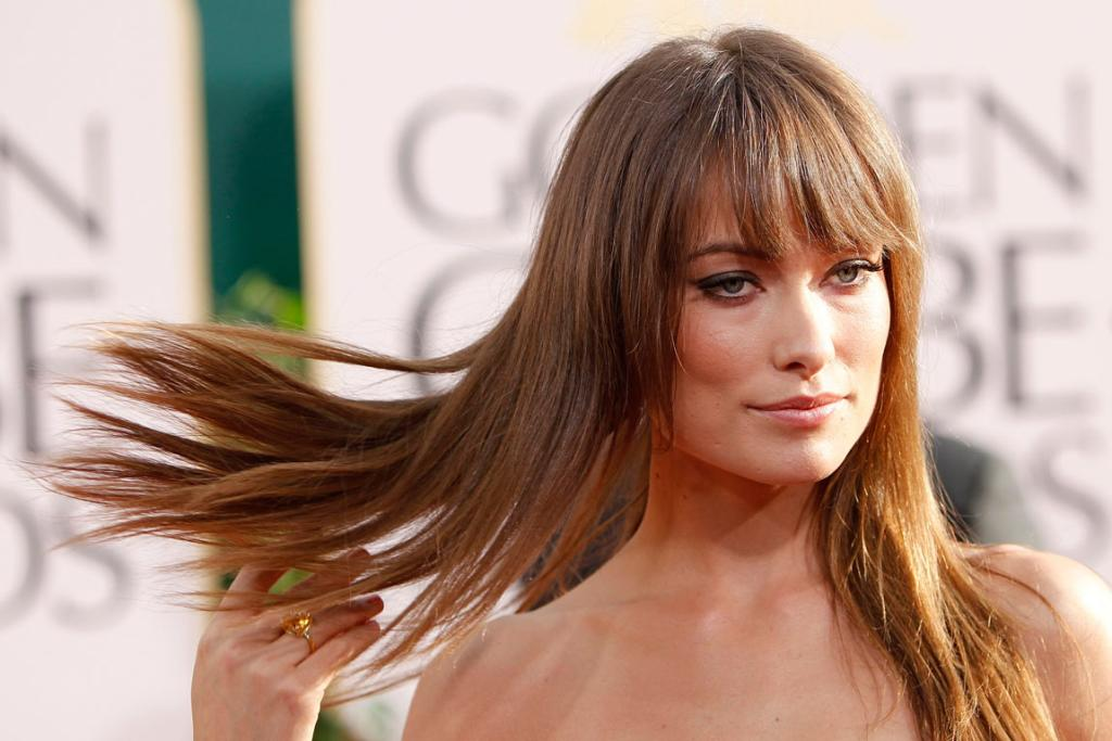 HAIR FLICK: Actress Olivia Wilde arriving at the 68th Annual Golden Globe Awards.