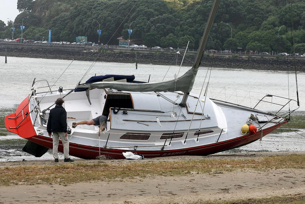 BEACHED AS: A yacht runs aground in Okahu Bay.