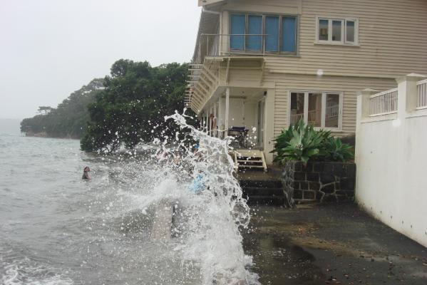 WET WALLS: Waves washing against apartments along Pt Chevalier Beach in Auckland.
