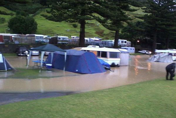 A flooded camping ground at the base of Mount Maunganui.