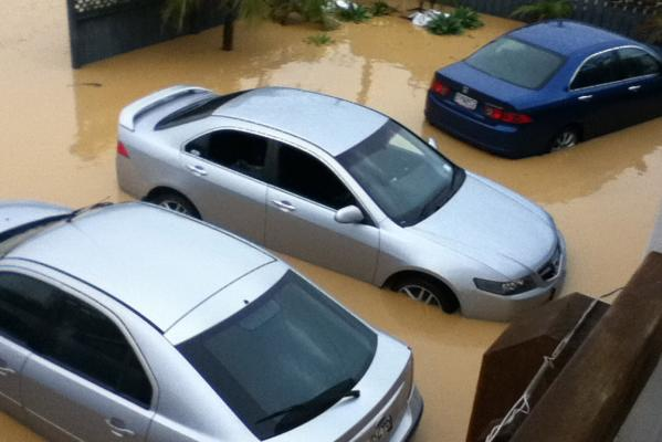 Cars are surrounded by floodwaters in Kaiaua. Water levels were up the vehicles' windows during the worst of the flooding.