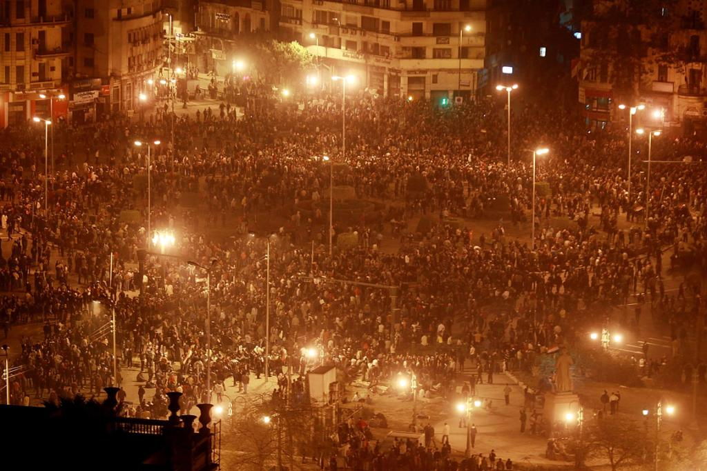 Thousands of protestors gather in Tahrir Square, Cairo, despite a curfew.