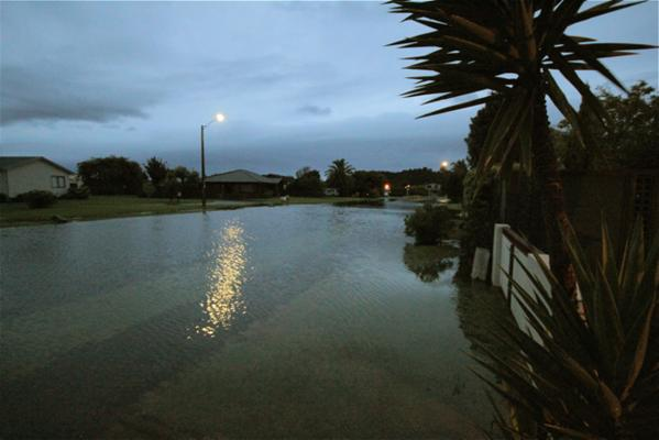 A flooded street in central Whitianga.