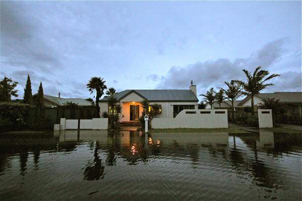 A house is surrounded by floodwaters in central Whitianga.