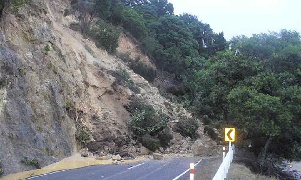 The main road to Coromandel is blocked with this slip at Ruamahunga Bay on State highway 25, north of Thames.