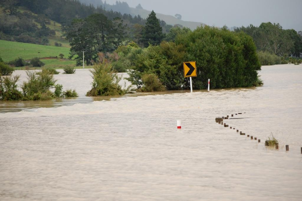 The main road out of Pauanui is well under water.