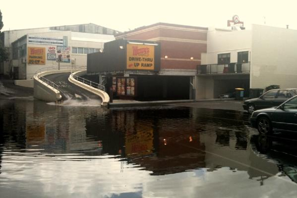 Surface flooding around the Dominion Road area in Mt Eden makes the Wendy's carpark and drive-through difficult to access.