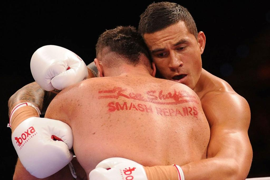 Sonny Bill Williams and Scott Lewis hug it out.