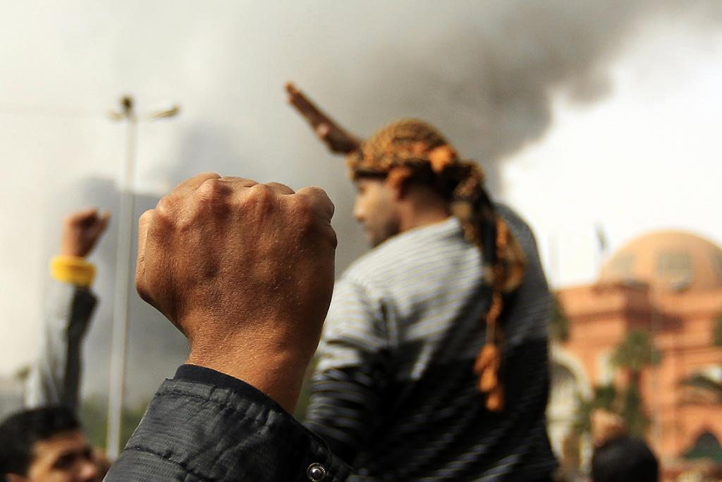 A man pumps a fist during a protest in Cairo.