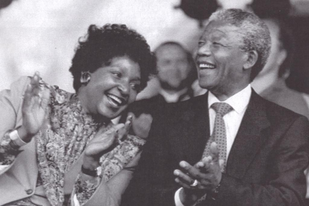 Mandela sharing a laugh at a rally in Toronto, in 1990.