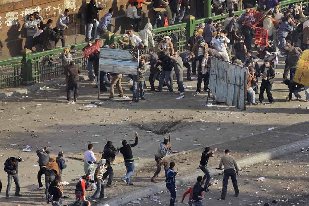 The two sides faced off at a front line next to the famed Egyptian Museum at the edge of central Tahrir Square.