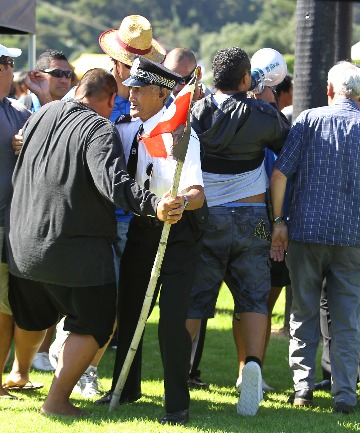 Wikatana Popata (with loud hailer) and his small group of supporters are pushed back by Maori wardens and officials as Popata challenges John Key and his Government as they arrived for the Wataingi Day celebrations.