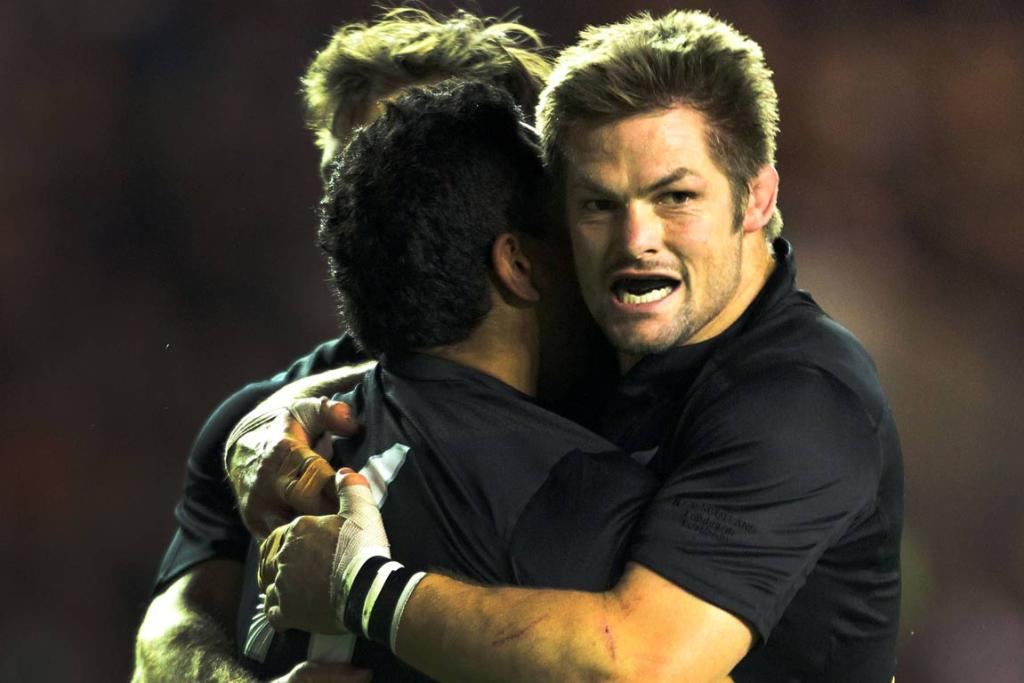 Richie McCaw hugs Hosea Gear after his first try during the New Zealand vs Scotland rugby test.
