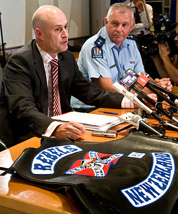 JOB WELL DONE: Police are also investigating a Palmerston North finance company, Detective Inspector Chris Bensemann, left, said after raids on criminal gang strongholds. Looking on at a press conference was Central District area commander Superintendent Russell Gibson.